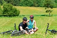 Sport mountain biking couple relax sunny meadows