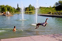 Argentina, Mendoza, Parque General San Martin, public park, artificial lake, water, Hispanic, boy, teen, swimming, swim, cool off, dive, diving, fun, ...
