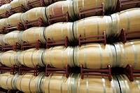 stacked wine barrels to ferment the wine, La Rioja, Spain