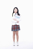 schoolgirl standing and holding a folder