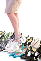 pretty young woman with buying shoes addiction, isolated on whit