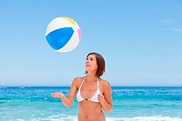 Lovely woman with her ball on the beach