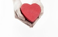 Hands holding a heart_shaped gift box