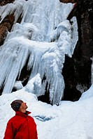 Man and frozen waterfall