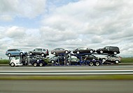 Car Transporter Carrying New Cars on Highway