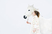 Girl with white horse