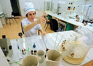 Pharmacy laboratory. Pharmacist mixing chemicals in a lab. Photographed in Veliky Novgorod, Russia.