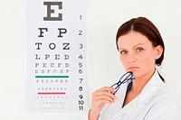 Pretty female optician and eye test