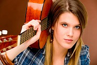 Rock musician _ fashion woman holding guitar