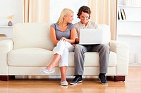 In love couple using a laptop