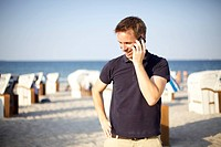 Man with telephone on a beach