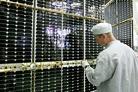 GLONASS satellite assembly. Technician assembling the solar batteries for GLONASS_K navigation satellites. GLONASS is the Russian global positioning s...