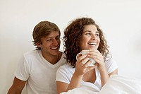 Couple having coffee in bed