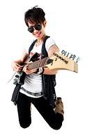 Punk Rockstar holding a guitar