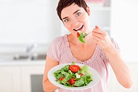 Good_looking woman eating salad