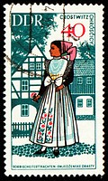 Young woman in national costume on post stamp