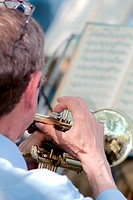Musician plays the trumpet