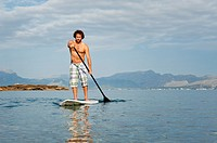Stand Up Paddle Surf in mediterranean sea Majorca in summer