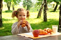young girl eat croissant