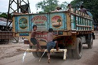 two child labor ridding to a running truck, it is one kind of game for them Bholagonj is located on the northeastern part of Bangladesh Bholagonj ston...