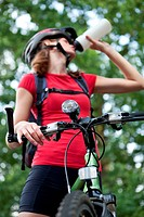 pretty young female biker outddors on her mountain bike