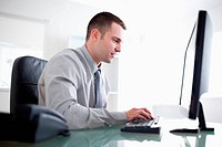 Businessman working concentrated on his computer