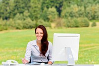 Businesswoman in nature attractive smile computer
