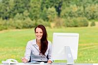 Businesswoman in nature attractive smile computer