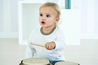 Baby boy playing drums