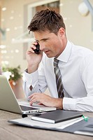 Businessman working with laptop and mobile phone