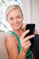 Portrait of woman using mobile phone (thumbnail)