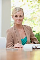 Portrait of businesswoman in office (thumbnail)