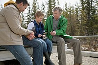 Three generations of men prepping for fishing
