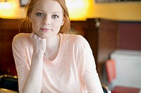Portrait of pretty, young adult woman in cafe