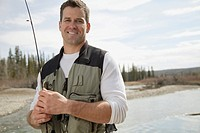 Handsome, mid_adult man fishing