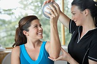 Physical therapist guiding mid-adult woman (thumbnail)