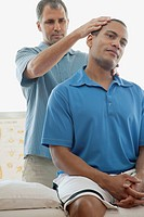 Male patient receiving a chiropractic adjustment