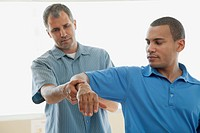 Male patient receiving a chiropractic adjustment (thumbnail)