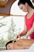 Woman receiving alternative health cupping therapy
