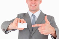 Businessman pointing at a blank business card