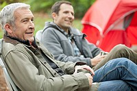 Senior man and adult son out camping (thumbnail)