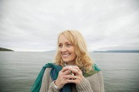 Attractive middle-aged woman at the lake (thumbnail)