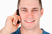 Close up of a smiling man on the phone
