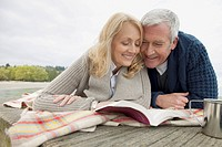 Mature couple enjoying a book together