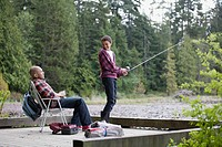 Father and son enjoying fishing together