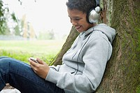 Pre_teen listening to music outdoors