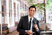 Businessman with cellphone and backpack