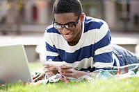 College man using computer technology outdoors