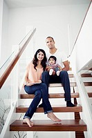 Parents with baby girl 6_11 months sitting on steps