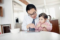 Father with daughter 2_3 using digital tablet